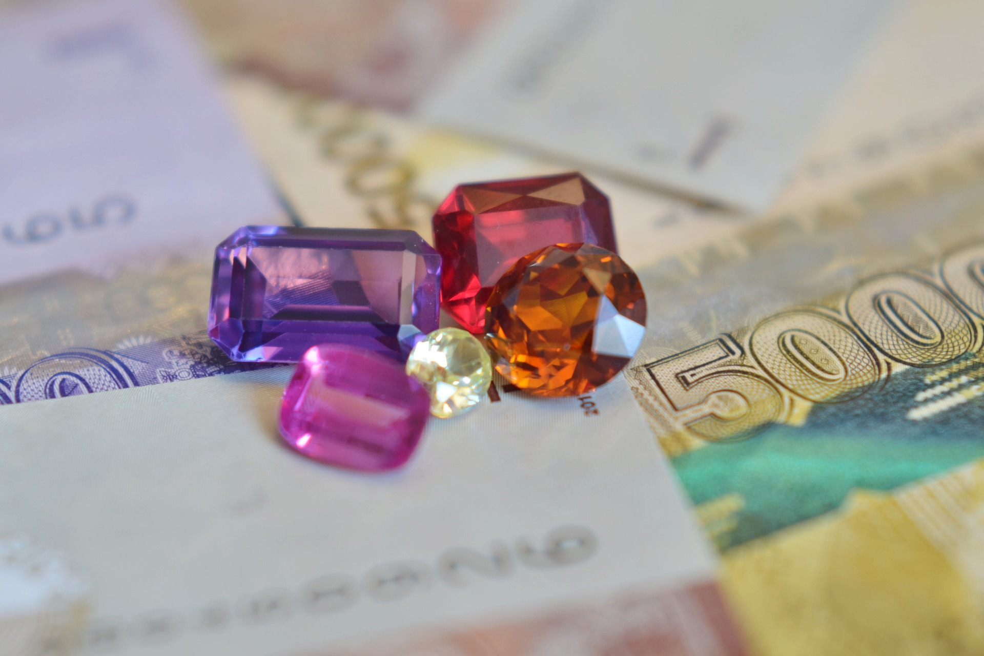 Opals and Emeralds: Precious Gem Industries in Australia and Latin America