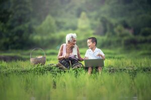grandmother and child with laptop